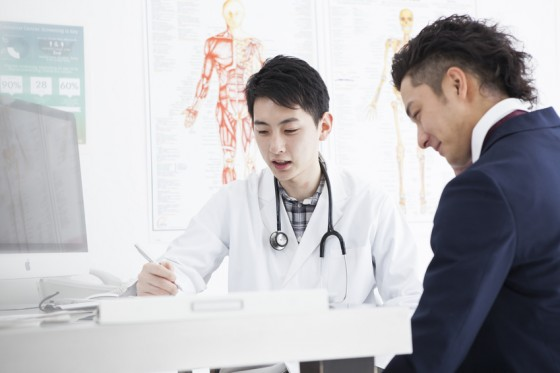 A businessman is undergoing a medical examination