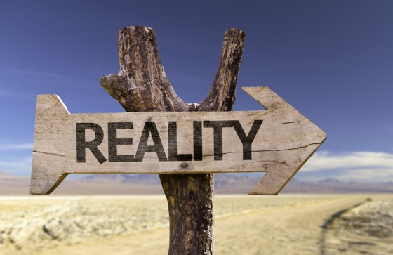 Reality wooden sign with a desert background